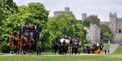 three of the many coaches, heading down the Long Walk, with a portion of Windsor Castle in the background