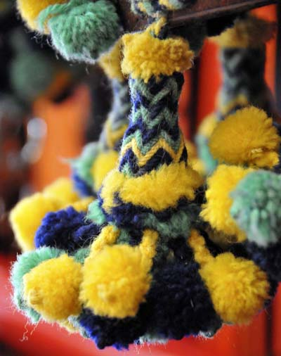 a close-up look at a single pom-pom, which would be one of about 30 on a bridle