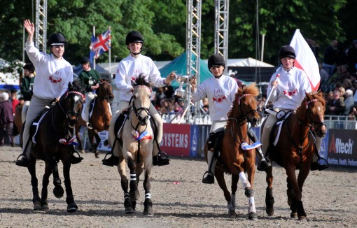 the members of the team from England celebrate their victory in the Pony Club games, which go on throughout the show (with the final on Sunday) and which pit England against teams from Wales, Scotland, Ireland, and Northern Ireland