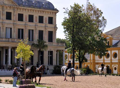 the back of the palace (the exhibition hall is to the right) and the outdoor practice arena at the riding school