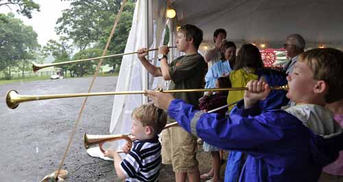 on Saturday, the youth had fun with horn-blowing lessons from Rich O'Donnell