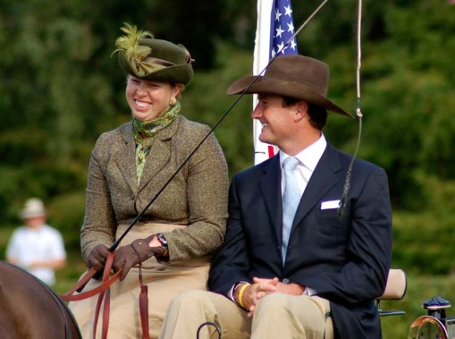Suzy Stafford (in fourth place, our best U.S. finisher in the dressage phase) and Chef d'Equipe Chester Weber share a laugh during the dressage awards ceremony (photo by A.J.)