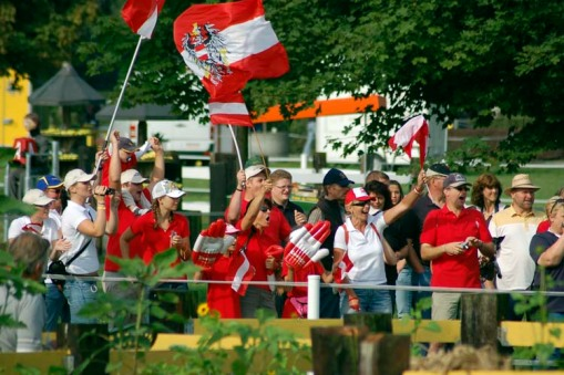 Austrian fans decked out in red and white (photo by A.J.)