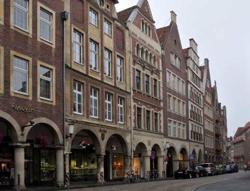 a long line of old buildings, and newer buildings built to look old, in Münster's old town