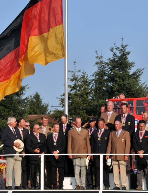 the German team members (and the fans) all sang along to the German national anthem as the huge flag was raised over the podium